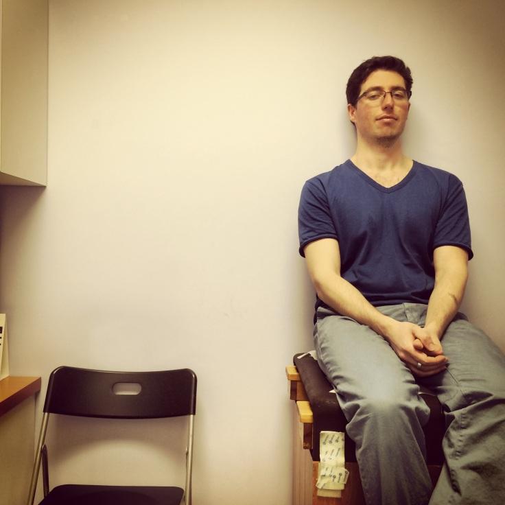 Dan waiting for his vaccination.