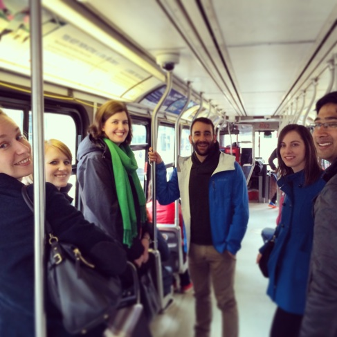 Aussie fellows on King St streetcar after a Saturday morning brunch.