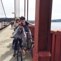 Cycling across the Golden Gate Bridge, San Francisco.