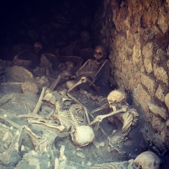 Copies of skeletons found at beach level. Ercolano, Italy